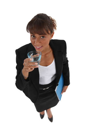 Businesswoman drinking a glass of water photo