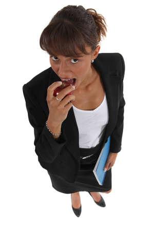 business dinner: Businesswoman eating apple
