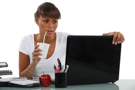slushy: Business woman drinking at desk