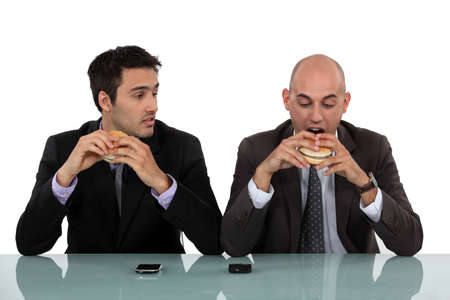 businessmen eating hamburgers photo