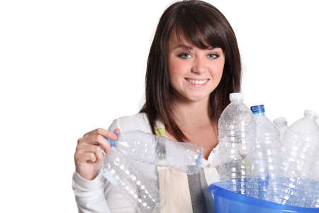 recycle plastic: woman gathering bottles