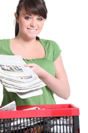 wastepaper: Woman recycling newspaper