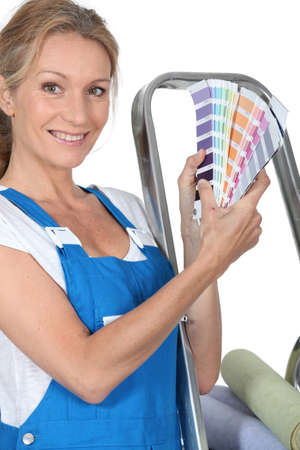 color range: A woman wearing dungarees and showing us a range of colors.