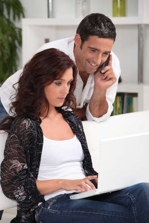 Couple ordering on-line photo