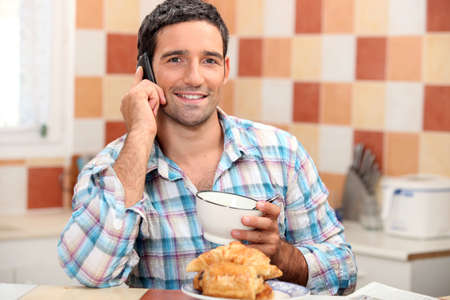 everyday people: Man having breakfast Stock Photo