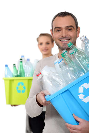 Couple recycling plastic bottles Stock Photo - 18740753