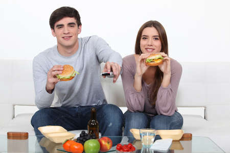 Couple eating junk food photo