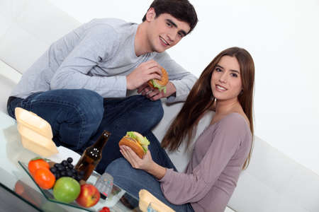 Couple eating burgers photo