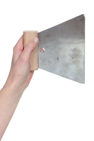 upholster: Hand holding a spreader
