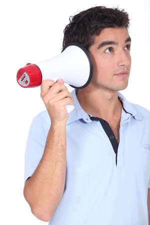 protestor: Amusing studio shot of man with a megaphone Stock Photo