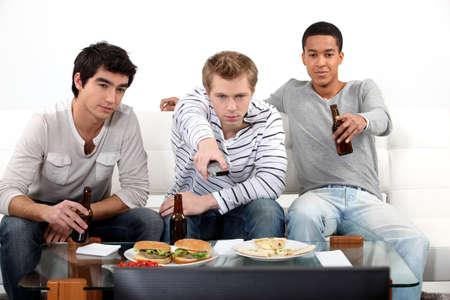 watching football: Young men watching a football game