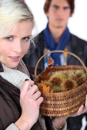 Couple gathering chestnuts Stock Photo - 18740903