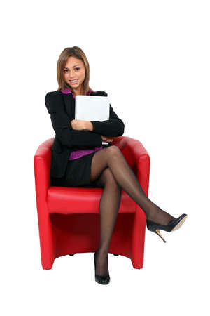 ravishing: Attractive businesswoman sitting in a red chair