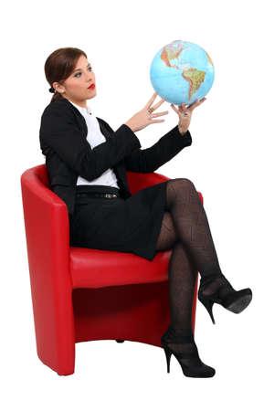 businesswoman holding a globe photo