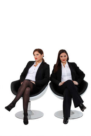 nylons: Businesswomen sitting side by side