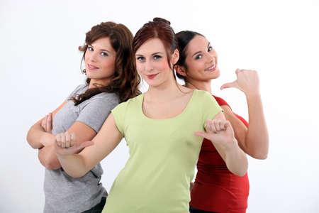 indicating: Three close female friends Stock Photo