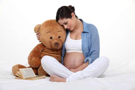 Pregnant woman embracing motherhood Stock Photo