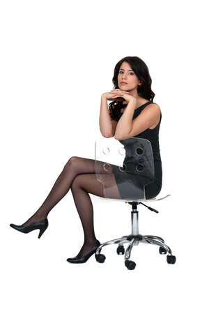 Attractive woman sitting on a chair photo
