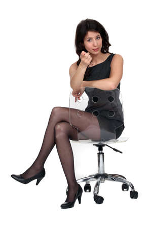 splendid brunette sat on chair photo
