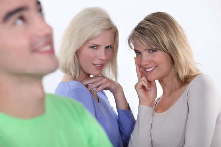 showoff: Two girls lusting over man Stock Photo