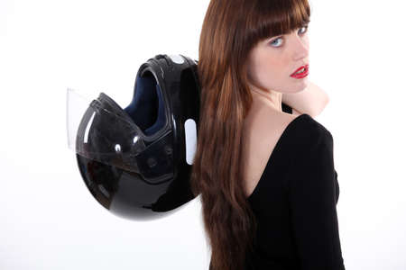 young woman holding a crash helmet photo