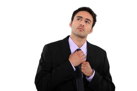 banker: Businessman straightening his tie