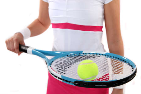 tennis racket: Tennis player holding her racket and ball