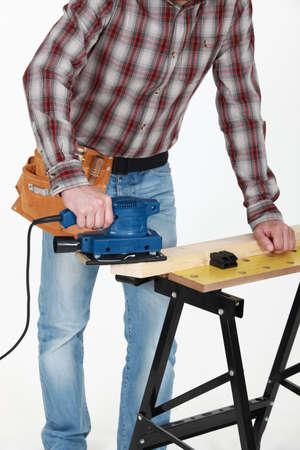sander: carpenter at work with sander machine Stock Photo