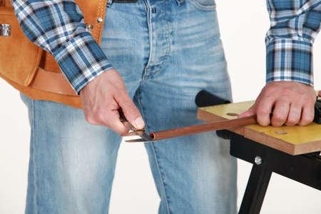 workbench: closeup of carpenter working on workbench