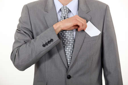 smartness: businessman taking out business card