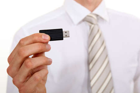pocket pc: Businessman holding USB stick
