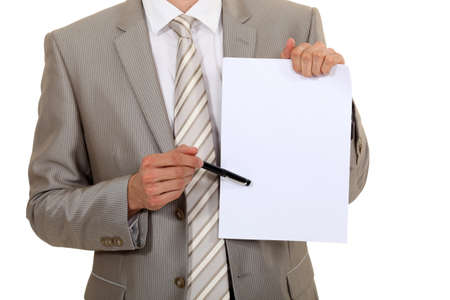 man in suite: Businessman pointing to a blank sheet of paper