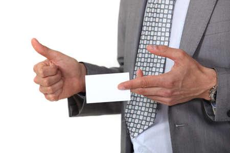 Man displaying business card Stock Photo - 18740781