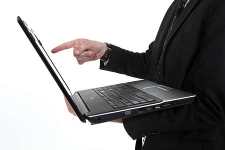Man pointing at laptop screen photo