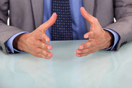 body language: closeup on businessmans hands during speech Stock Photo