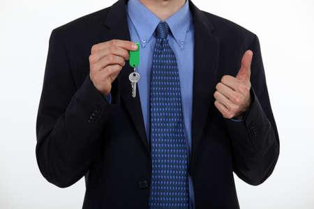 doorkey: Agente immobiliare con un doorkey