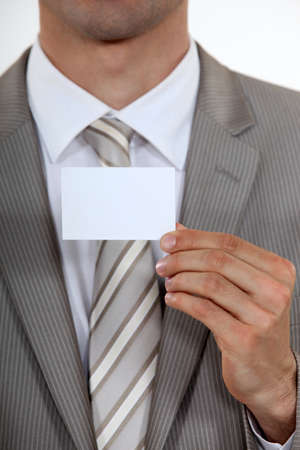 Executive with a blank business card Stock Photo - 18740837