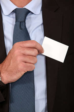 hands in pockets: Man removing business card from pocket