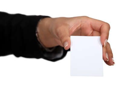 Female hand holding a business card. photo