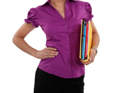 A cropped picture of a businesswoman with a folder. photo