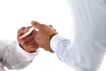 business card hand: Two businessman exchanging cards.