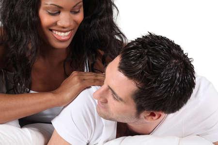 Woman massaging man photo