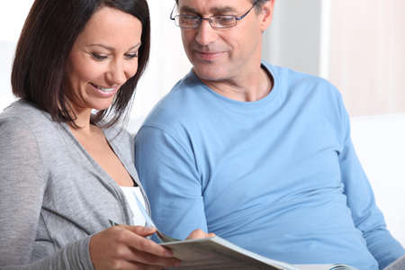 Couple looking at photos Stock Photo - 18817483