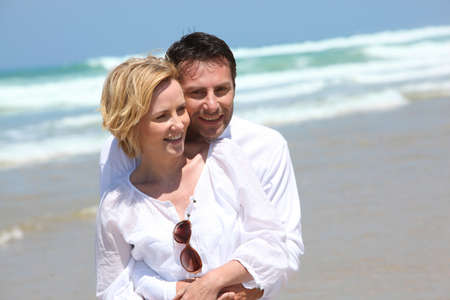 accomplices: Couple walking on a beach Stock Photo