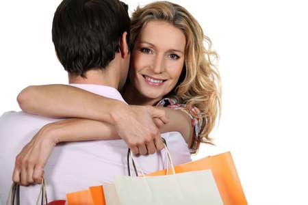 Woman embracing man photo