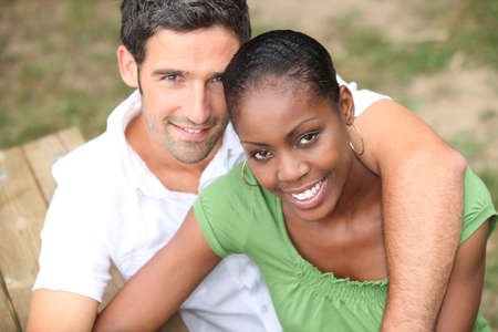 mixed marriage: Interracial couple in a park Stock Photo