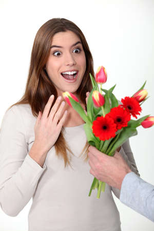 agape: Woman receiving bouquet of flowers