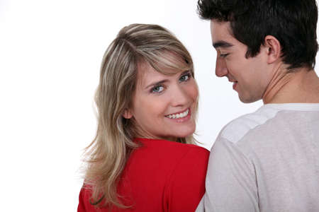 flirtatious: Young man and pretty young woman with bright smile