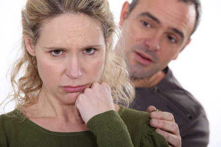 humiliated: Man trying to comfort his grumpy wife
