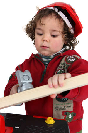 Little boy playing builder photo